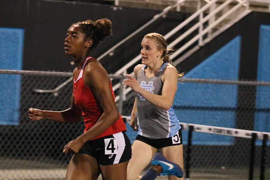 Senior+Lea+Duben+warms+up+before+her+300-meter+hurdle+race.+Duben+recently+committed+to+the+University+of+Alabama+where+she+will+continue+her+track+and+field+career.+