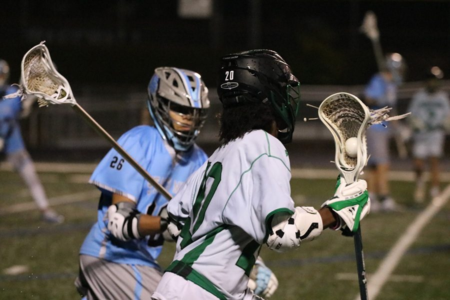 Sophomore Gabe Fernandez defends junior Chief Jabari Holifield. The Starr's Mill defense locked down McIntosh in the second half, only allowing one goal. The Panther offense scored nine goals in the half, leading to the Mill clinching a home playoff game in the first round.