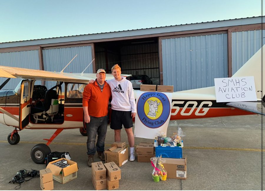 Aviation Club president senior Preston Harris (right) and his father, Huey Harris (left), stand in front of their Cessna 172 airplane alongside the donations that were collected for the victims of tornadoes in southeast Alabama. The donations came from Starr's Mill students and other local businesses.