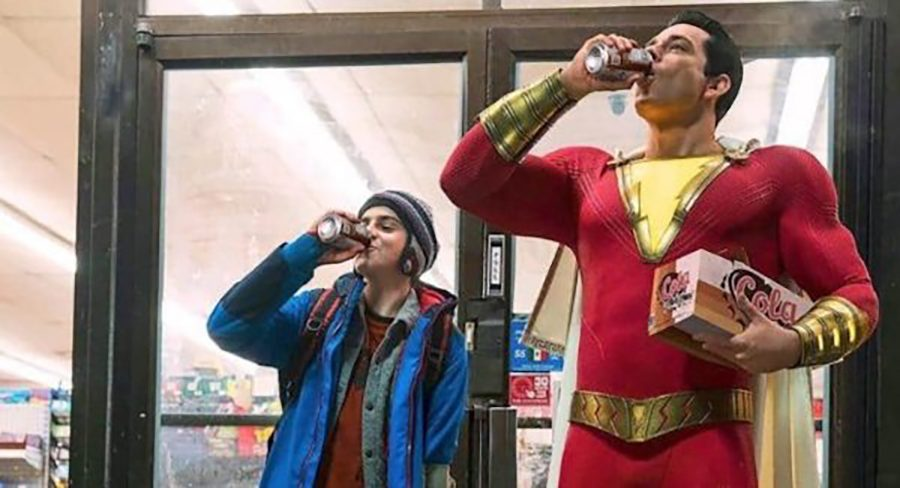 Shazam%21+and+Freddy+take+a+swig+of+cola+together+in+DC+Universe%E2%80%99s+newest+movie.+The+film+is+full+of+action%2C+humor%2C+and+heart+that+anyone+can+enjoy.+