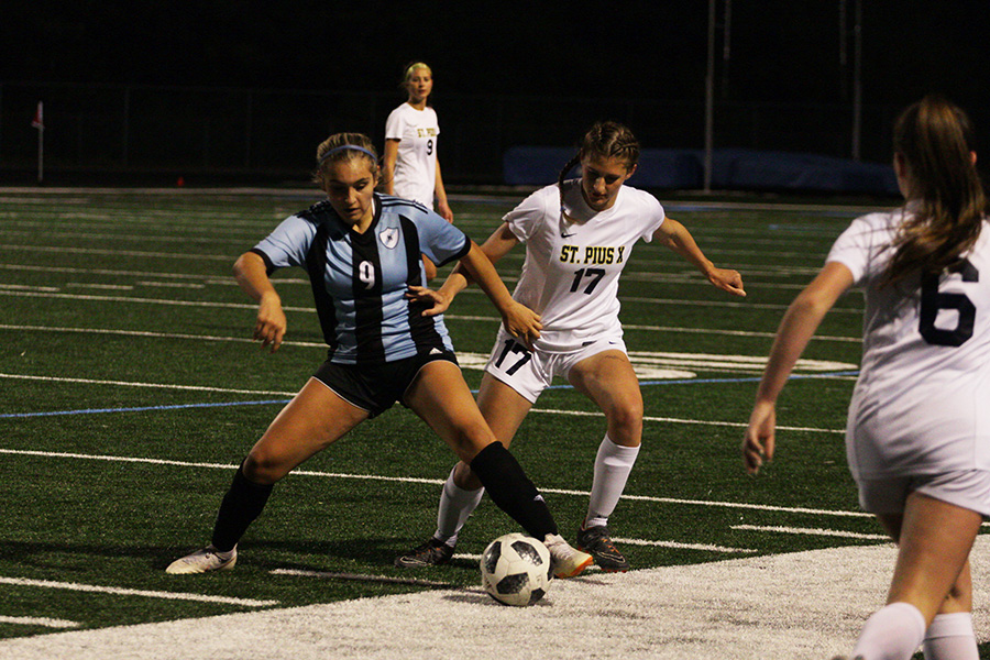 Freshman Lady Panther Sophia Bernardi attempts to keep junior Golden Lion Laney Polvino away from the ball. In the last regular season home game, Starr's Mill faced St. Pius X. The Mill was defeated 3-0 after struggling to keep control of the ball.
