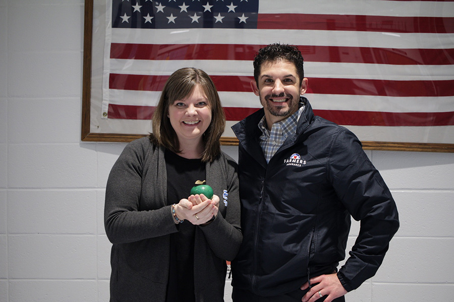 Tim Monihan from Farmers Insurance pictured next to this month's Golden Apple winner, Dr. Lela Crowder. Crowder has been selected for this award by previous winner, Rick Wright, because he thought she had gone above and beyond what other teachers do to make a newcomer feel welcome.