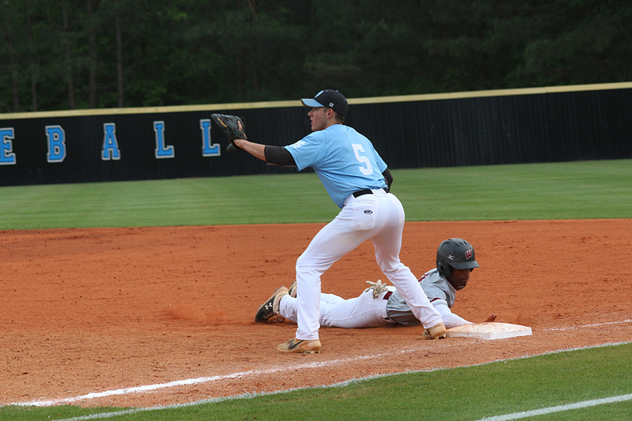 Senior Ryan Henderson attempts to catch a runner stealing. The Panther defense played tremendously in the final two games of the series, only allowing two combined runs.