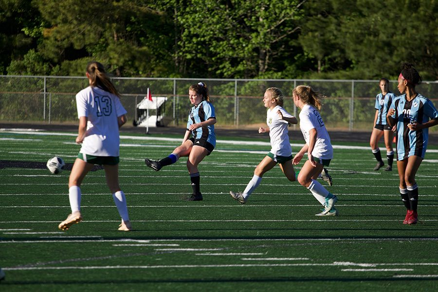Senior Rachel Davison kicks the ball while two defenders attempt to get control of the ball. Davison scored her only goal in the 52nd minute of the second half. The Mill then went on to score three more goals.