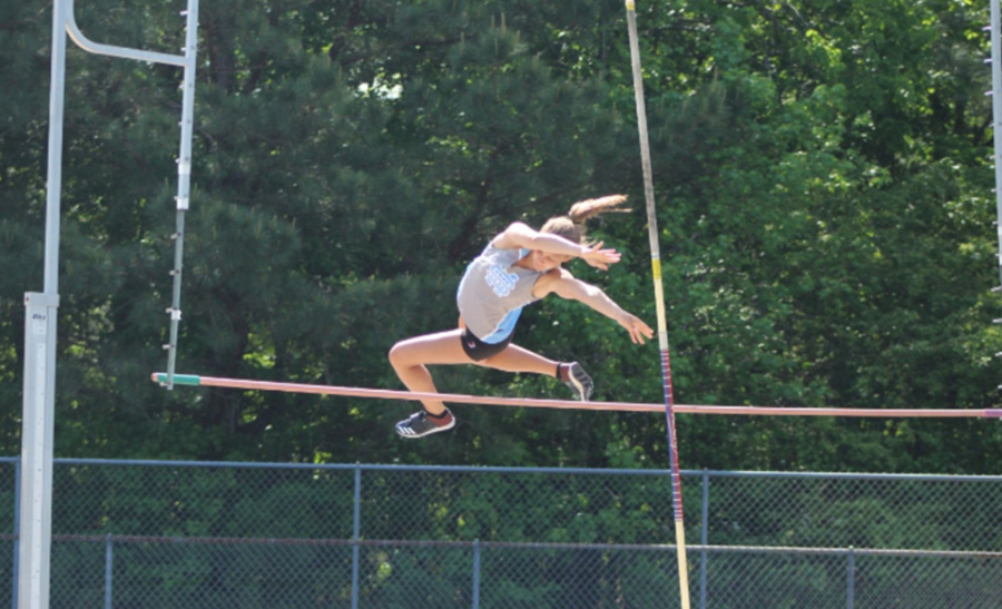 Junior+Julia+Colson+clears+the+bar+in+the+pole+vaulting+event.+Colson+placed+first+with+a+jump+of+11+feet.+Junior+Jenna+Sulkowski+placed+second+with+a+jump+of+9.5+feet.