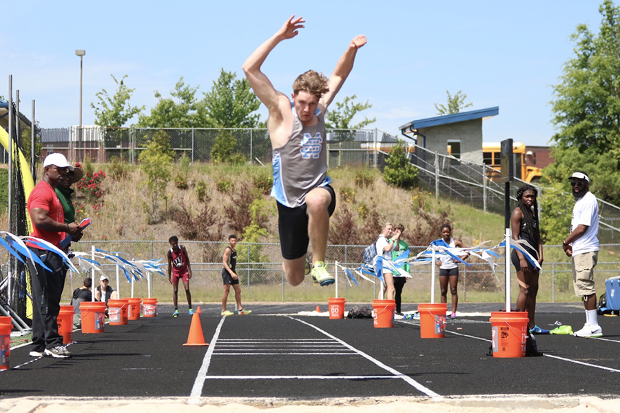 Senior+Will+Doil+executes+a+triple+jump.+Doil+placed+seventh+with+a+jump+of+40+feet.+Amanuel+McDowell+from+Griffin+placed+first+in+boys%E2%80%99+triple+jump+with+a+jump+of+45.03+feet.+