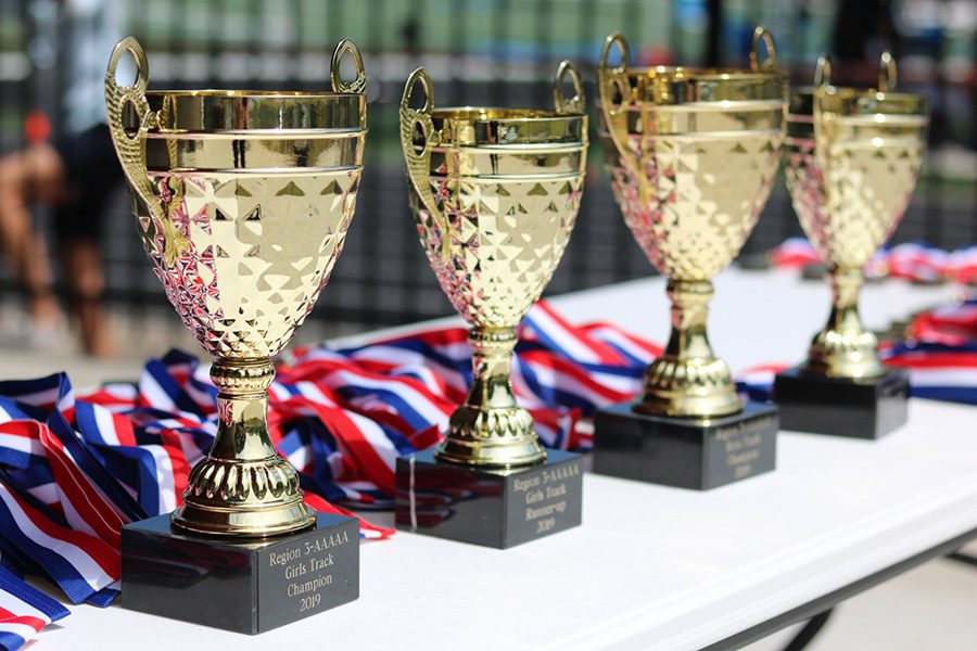 April 24, 2019 - Trophies and medals lay on a table during the Region 3-AAAAA track meet.