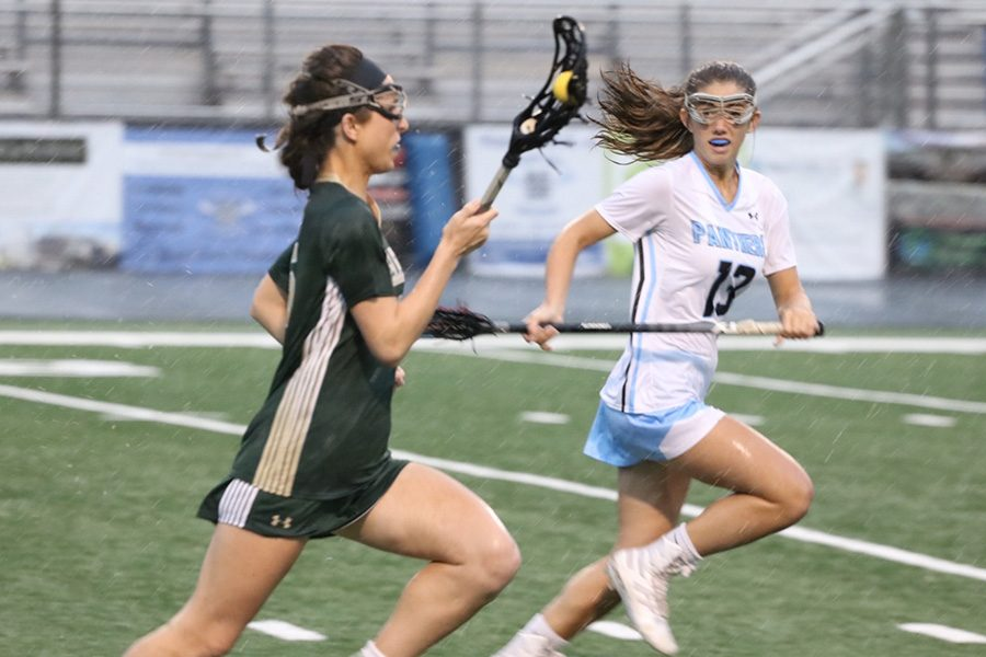 Freshman Briley Kalen defends a Wesleyan player. Fellow Freshman Emma Grace Hepler led the offense for Starr's Mill, scoring multiple goals in the Lady Panther 21-point showing. Their high-powered offense will take on Fellowship Christian in the Final Four.