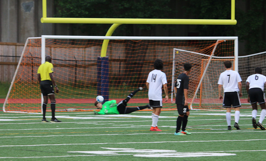 Senior Michael Lantz saves an attempted goal off a penalty kick. Lantz was a big part in the 2-0 win, saving all eight shots on goal by the Indians. With this win, the Panthers have yet to be scored on in the postseason, outscoring their opponents 14-0.