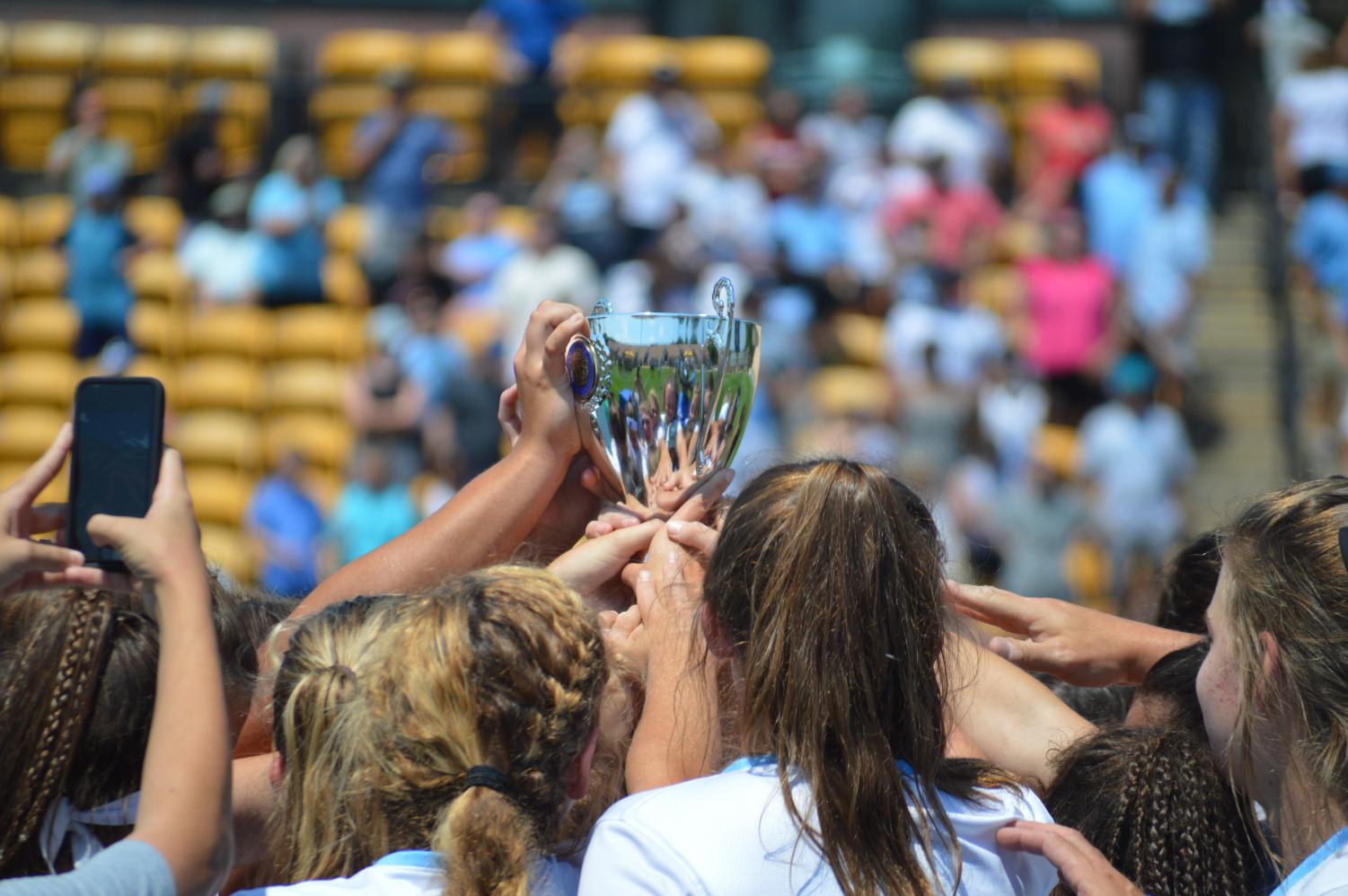 Lady Panther lacrosse team raises the championship trophy. Starr's Mill defeated Blessed Trinity 11-8 to win the GHSA A-AAAAA State Championship, becoming the first team south of I-20 to do so.
