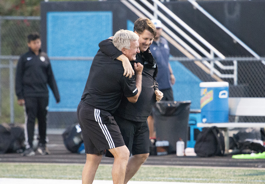 Coach Mike Hanie (left) hugs next year's boys' varsity soccer head coach Aaron Buck (right) at the Final Four game of the playoffs. The Panthers defeated Johnson 1-0 in overtime in the Final Four game, sending them to a rematch of the 2010 GHSA State Championship game against McIntosh where Hanie earned his second ring with Starr's Mill. Following this Saturday's match, Hanie will retire after 22 years of working at Starr's Mill.