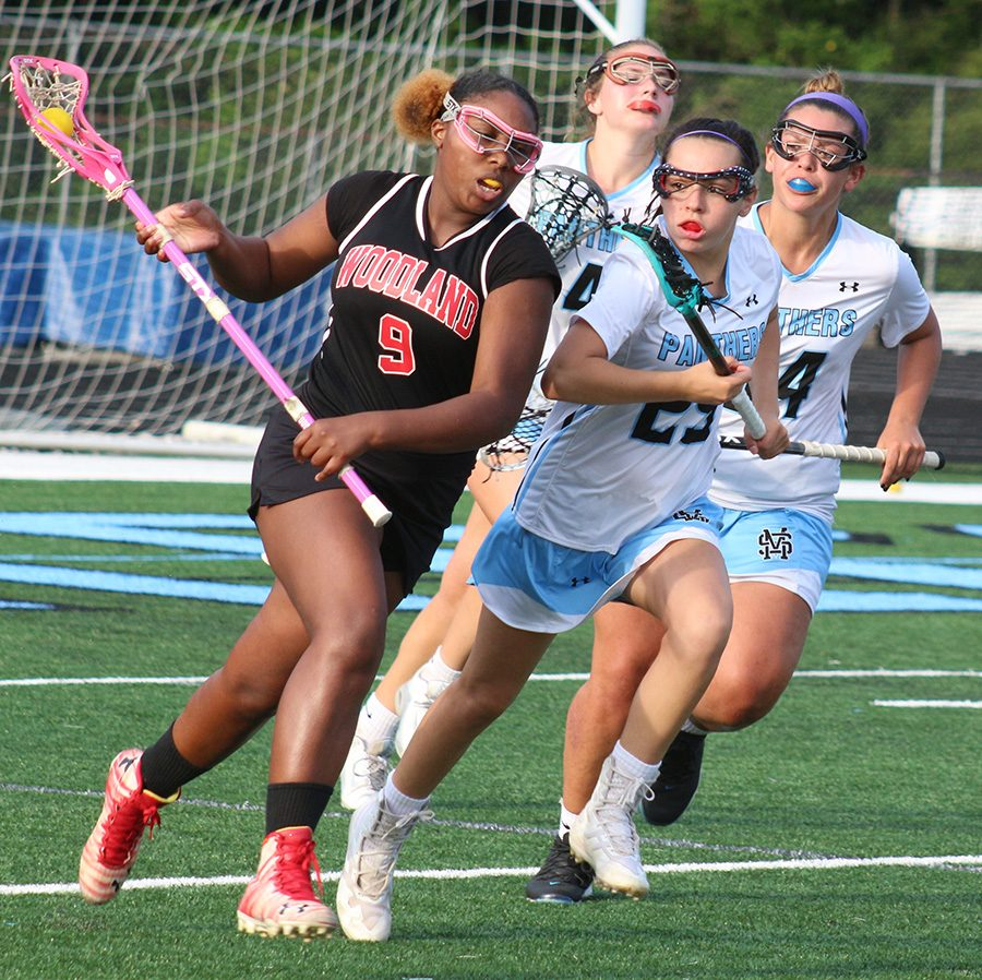 Freshman Hannah Leon chases down a Woodland player. Leon scored three goals all in the first half against the Wolfpack. She joined four other Lady Panthers that had a hat trick in the team's win.