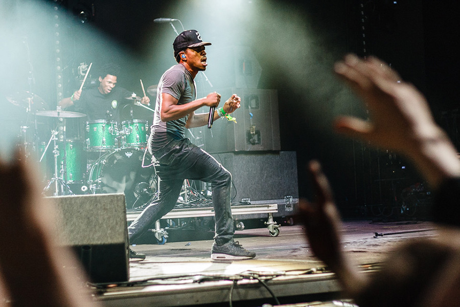 Chance the Rapper performs in front of a huge crowd. Chance, originally from Chicago, has put his own unique spin on rap with upbeat, inspiring lyrics and music. A perfect summer album has both songs to put you in a good mood that you can sing along with during the day and has songs to relax to late at night.