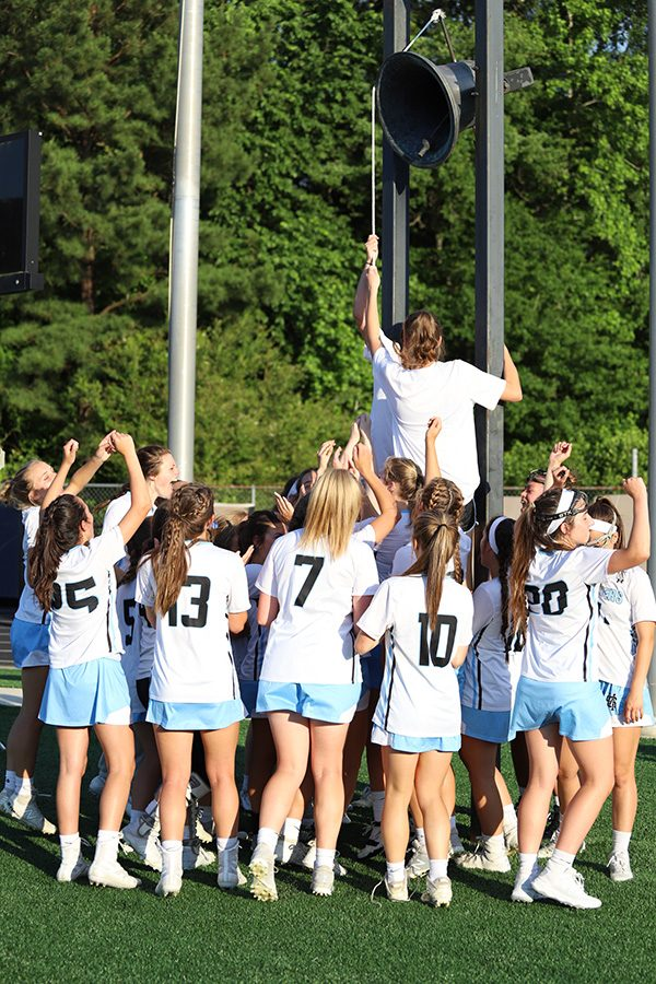 Lady Panthers team ring the victory bell after their 19-2 win over Fellowship Christian. Junior Ryanne King led the team with seven goals. The Mill is stacked with offensive firepower, and they look to utilize it in a championship rematch against Blessed Trinity.