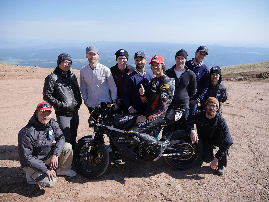 Panther grad Kento Masuyama (lower left) poses with his electric motorcycle racing team at Pikes Peak, Colorado. Masuyama now lives in Tokyo where he works as a satellite systems and propulsion engineer.