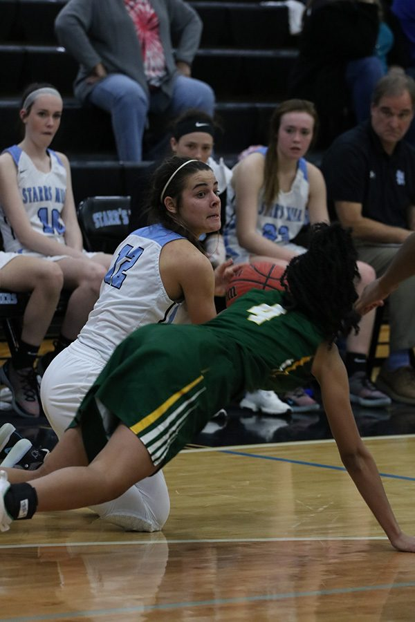Angelo dives for a lose ball against Griffin. Angelo is known for her hustle as an athlete. In every sport she played, she displayed a great nose for the ball.