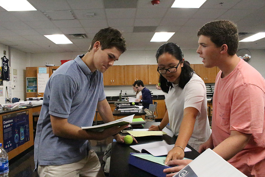 Aug.+19%2C+2019+-+Seniors+Jacob+Shaeffer%2C+Margaret+Xiao+and+Noah+Stadelmeyer+work+on+a+lab+in+Nicholas+Gillies%E2%80%99+7th+period+physics+class.+In+AP+Physics+C+students+worked+on+a+lab+to+calculate+the+gravity+on+a+tennis+ball+when+dropped+from+various+heights.+