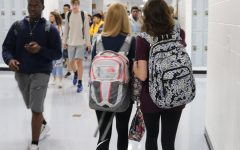 Students wearing bookbags leave their classes after the end of seventh period, the only period of the day when bookbags are allowed in classrooms. The administration argues that this new policy will provide the school with more safety, but in reality, it only creates more inconveniences for the students.