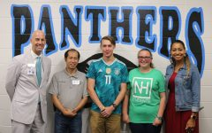 Principal Allen Leonard and teacher Adriah Williams stand with custodian Tri Ha, senior Zach Livsey, and freshman Courtney Mckenna. They were chosen as the first PBIS faculty member and students of the month.