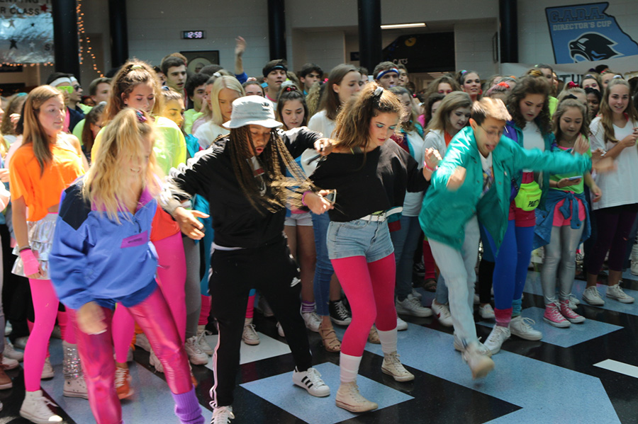 Students participate in the flash mob for Decades Day. Since students dressing up is not mandatory, it only makes sense to allow students to also choose whether or not they want to participate in the pep rally.