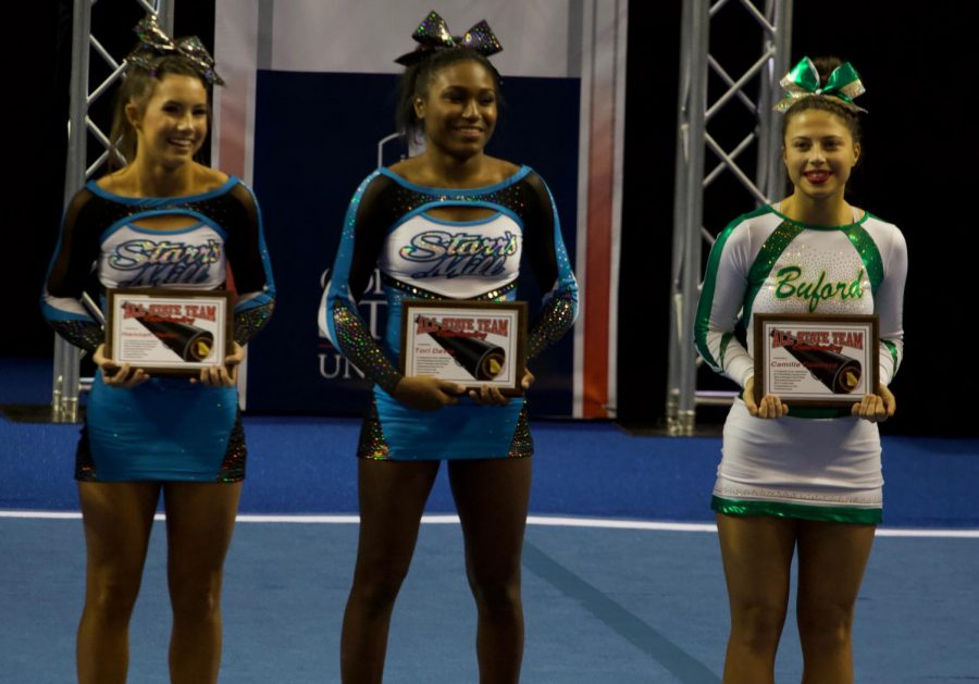 Tori Davis (middle) and Hannah Defler (left) at last year's cheerleading awards. Davis was named top 16 in the state and now joins the Texas A&M competition squad.