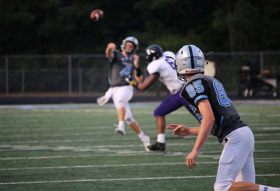 Senior Hunter Lawson throws the ball against Chapel Hill. Lawson found great success from the air in the loss, completing five of his nine pass attempts for 147 yards, two touchdowns, and one interception.
