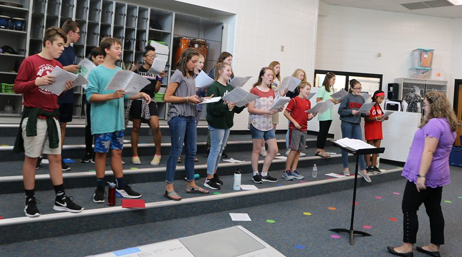 Middle+school+chorus+teacher+Bonnie+Krider+conducts+the+mixed+choir.++The+annual+fall+concert+will+be+at+6%3A30+p.m.+on+Sept.+26+at+Willie+Duke+Auditorium.+