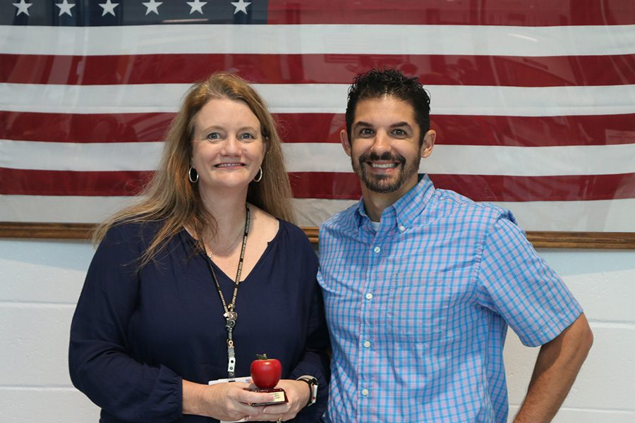Tim Monihan from Farmers Insurance is pictured with this month's Golden Apple winner Wendy Willoughby. Willoughby believes everyone here at Starr's Mill is capable of the Golden Apple award and thinks that all of the math department deserves it.