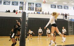Sophomore Nicole Smith sets up for a kill. Smith has led the team with 188 kills.