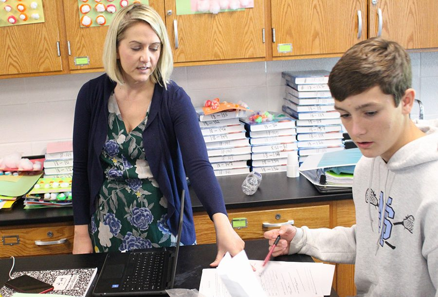 Christie Jarret assists student Micheal Johnson in a science lab. Students were separating bees to calculate the mass of certain atoms. Jarret says its important to have a personal bond with her kids.