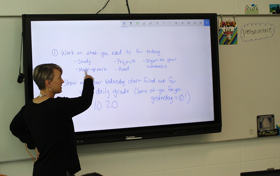 Laurie Bennet explains what her math class will learn during the day's lesson. Excited about continuing her 11th year teaching, Bennet plans on smiling and bonding with her students -- even before Christmas.