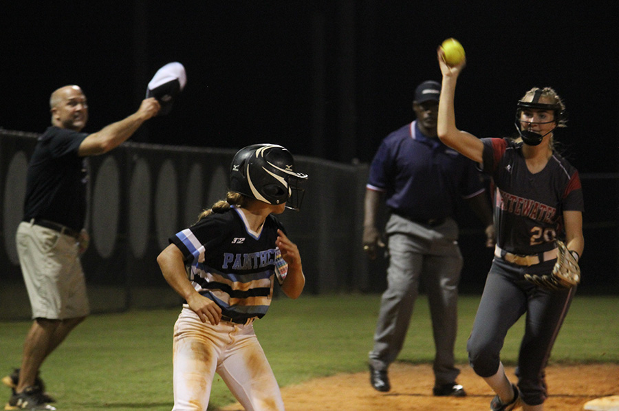 Junior Lauren Flanders runs between third base and home plate to avoid an out. In the three-game series, Flanders went 7-for-13, scoring three runs and stealing five bases. In the end, however, it was Whitewater hoisting the region trophy for the second year in a row after winning the series 2-1.