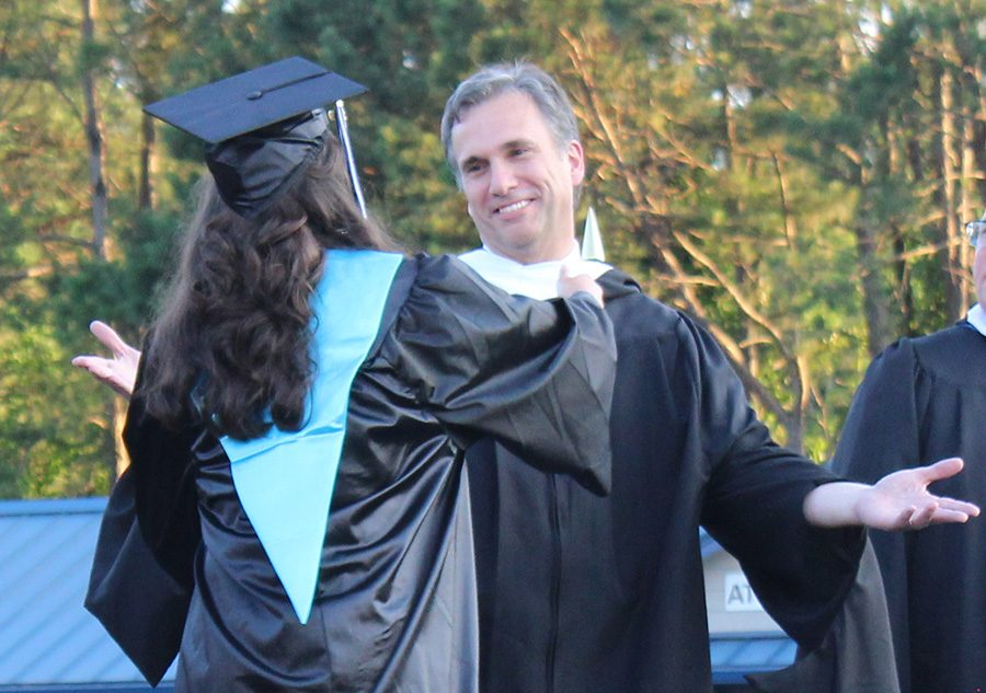 Physics teacher Craig Martin readies his arms to embrace his daughter Madison during graduation ceremonies for the class of 2019. This year, the Prowler looks to highlight Starr's Mill alumni who are related to faculty and staff.