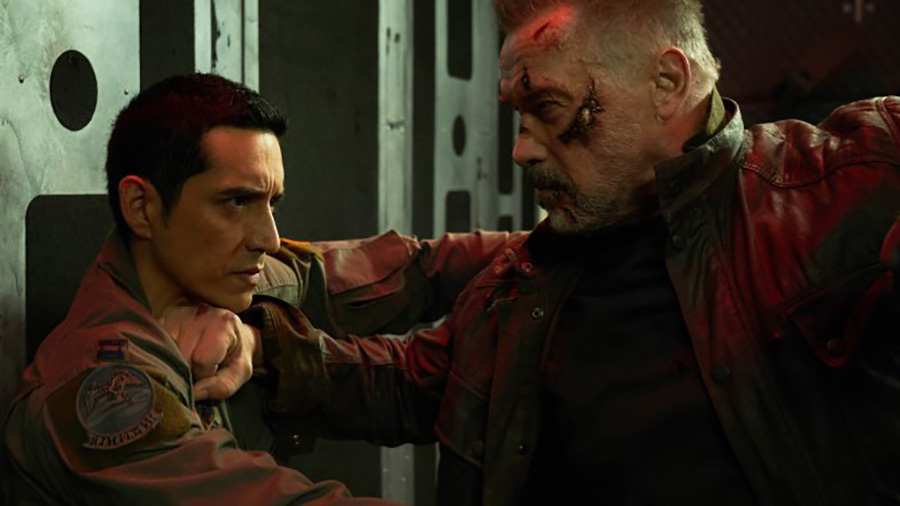 "The NEV-9, Gabriel Luna, locked in combat with the T-800, Arnold Schwarzenegger. ""Terminator: Dark Fate"" borrows a little too much from the movies that preceded it. Despite this, it is still an alright movie."