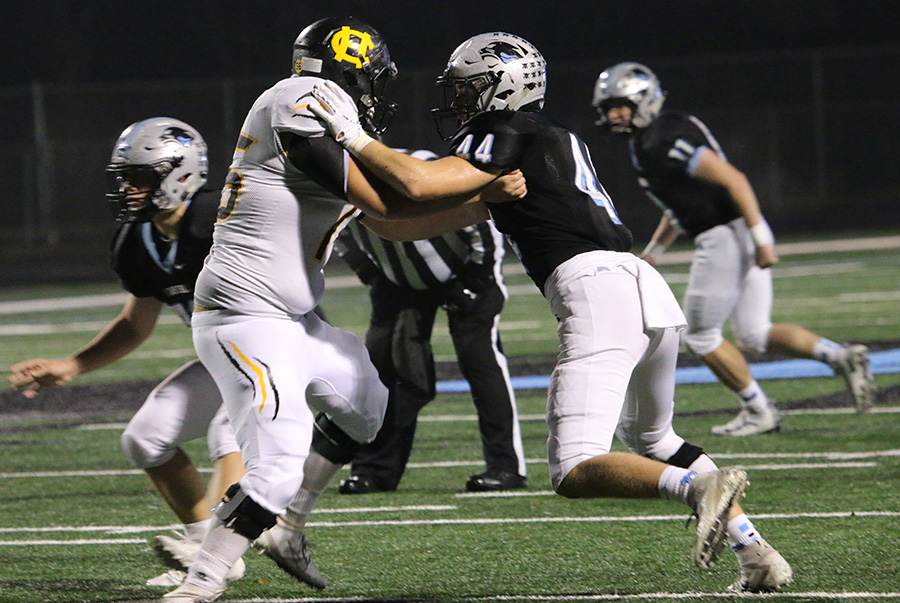 Sophomore Barrett Schmidlkofer looks to tackle an opposing Tiger. The Panther defense had one of their better performances this season, only allowing 163 total yards.