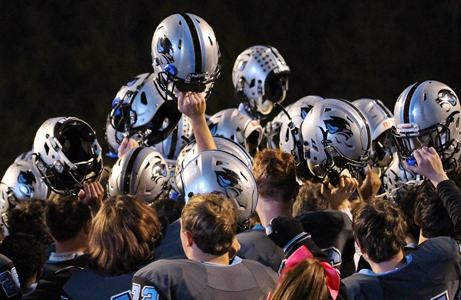 Panther football team raises their helmets in celebration after the win. Starr's Mill used a dominant offense and a lockdown defense to defeat Fayette County 49-7 en route to winning their fourth-straight region championship.