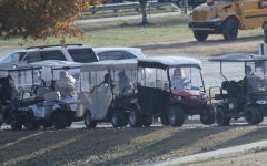 Golf cart drivers look back in line as they leave Starr's Mill to see one cart rear-ending another. The frequent accidents involving golf carts around the Mill call for stricter operating regulations.