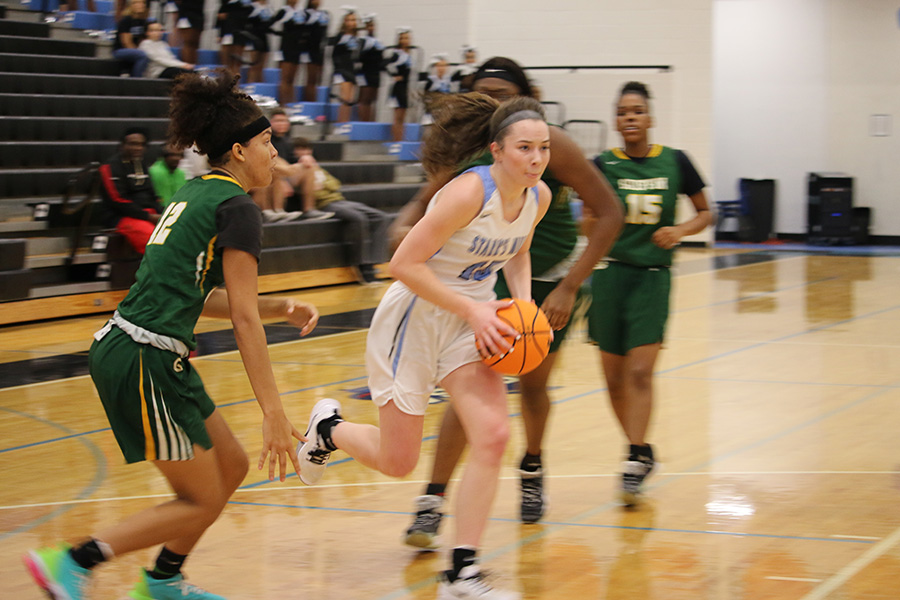 Senior Alice Anne Hudson drives down the lane for a layup. Hudson led the Lady Panthers in scoring with 17 points. She also kept the aggression on the defensive end, posting five blocks and three steals.
