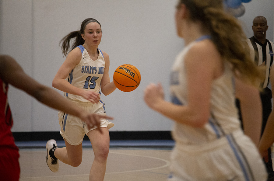 Senior Alice Anne Hudson takes the ball down the court against Jonesboro. On senior night Hudson scored 33 points, setting a new single-game scoring record for Starr's Mill girls' basketball. The previous record was 29 points.