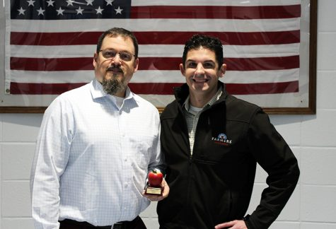 Timothy Monihan and Farmers Insurance recognize Rob Bell as January's Golden Apple Award recipient. Bell has brought growth to his program and the robotics club, and is passionate about biking against child abuse. December's recipient Rebecca Rickeard selected Bell for the award.