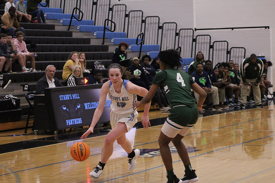 Senior Alice Anne Hudson drives down the lane against a Ram defender. Hudson posted 27 points in her final game as a Lady Panther. In her career, Hudson broke the single game scoring record, and surpassed 1,500 career points to become the all-time leading scorer in both girls' and boy's basketball.