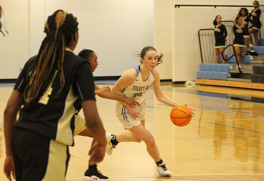 Senior Alice Anne Hudson moves around a defender. Hudson led the Lady Panthers with 14 points.