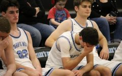 Senior Zac Cerniglia in tears on the bench in the final minutes of the first round region tournament match against the Jonesboro Cardinals. Cerniglia scored two points in his final game. The Panthers lost control in the third quarter to lose to Jonesboro by a final score of 60-42. The 2019-2020 boys' basketball team becomes the first team in Starr's Mill history to lose all region games in their schedule.