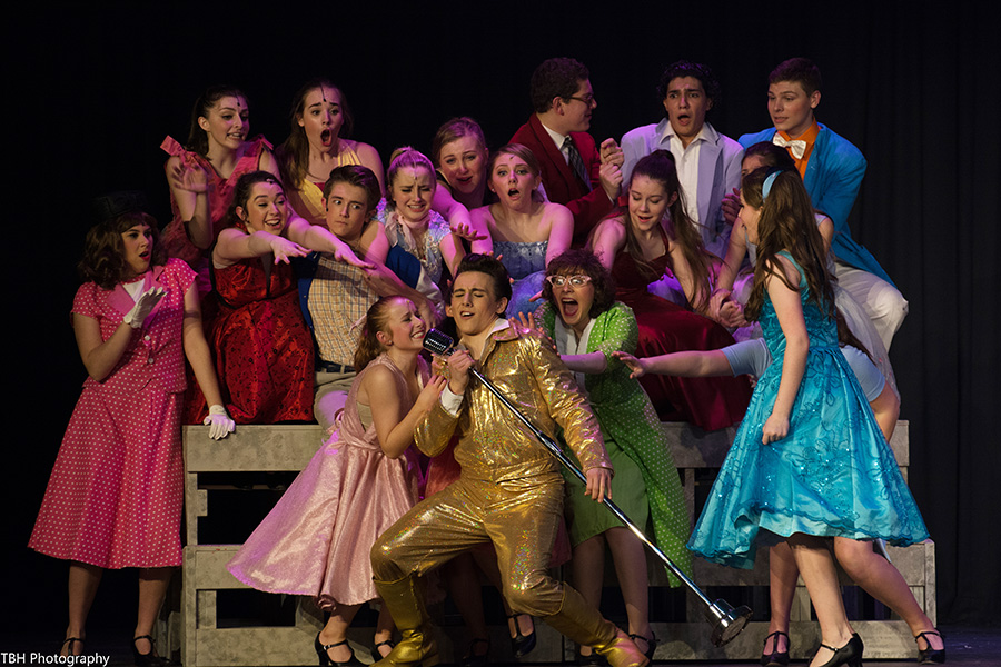 Conrad+Birdie%2C+played+by+Scotty+Hindy%2C+sings+as+he+is+adored+by+his+fans.+Last+weekend%2C+Starr%E2%80%99s+Mill+students+and+teachers+put+on+the+classic+musical+%E2%80%9CBye+Bye+Birdie.%E2%80%9D+Though+this+play+is+filled+with+a+talented+cast%2C+to+a+first-time+viewer+the+show+can+be+taken+in+a+way+the+light-hearted+play+does+not+intend.+