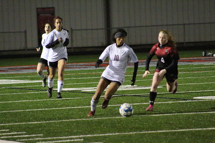 Junior Sara Evans looks to get the ball down the field. Evans scored both goals for the Lady Panthers and was the driving force on offense in the 2-1 win.