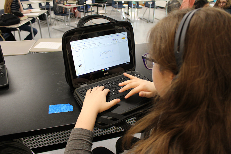 Freshman Maggie Wilson conducts research on a Chromebook in Dr. Bonnie Stanford's 7th period Creative Writing class. AP seminar would have been based on student learning and research on the Chromebooks, but plans for the new course fell through after not enough students chose to take new AP.