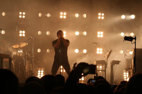 "Nine Inch Nails frontman Trent Reznor performs during a concert in May 2009. Concerts are a way of bringing fans together. With the outbreak of COVID-19, however, all concerts and other large social gatherings have come to a halt. On March 27, Nine Inch Nails released two albums back to back titled ""Ghosts V: Together"" and ""Ghosts VI: Locusts."" The ambient albums show the different ways society can react to the current global pandemic."