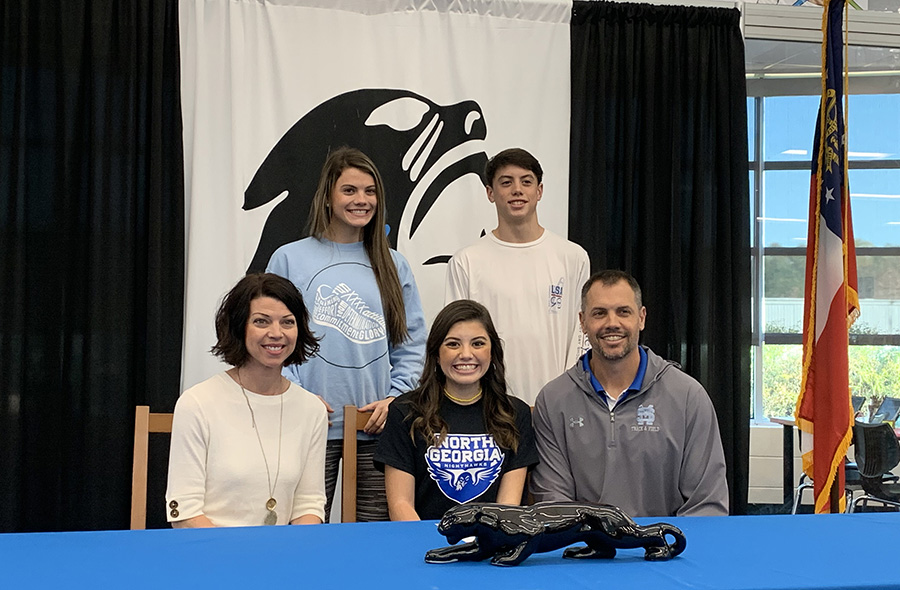 Walker family poses for a picture while Raney signs with University of North Georgia where she will run cross country. From a grandfather who played in the CFL, to a sibling who played in the Little League World Series, the Walker Family has seen its fair share of sports involvement.