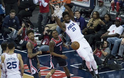 """Philadelphia 76ers forward and center Joel Embiid finishes a dunk. General manager Sam Hinkie coined the phrase """"Trust the process"""" when rebuilding the 76ers, with Embiid as one of the key components of the rebuild. I have had a wild journey from the beginning of the school year to now. Through my development as a journalist over the past year, my story is one of personal growth and trusting the process."""