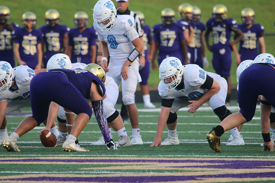 Sophomore+quarterback+Will+Yarbrough+lines+up+under+center+for+the+snap+during+the+Panthers%E2%80%99+season+opener+against+the+East+Coweta+Indians.+The+tight+contest+last+Thursday+proved+that+the+Panthers+were+coming+to+play%2C+despite+falling+short+in+a+21-20+loss.+The+offense+showed+promise%2C+the+defense+stayed+beyond+reputable%2C+and+the+culture+of+grit+proved+itself+as+strong+as+ever.